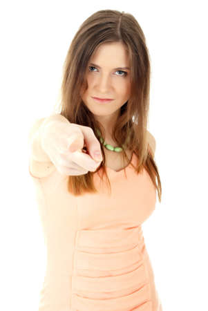 Portrait of a young businesswoman pointing at you. Isolated on white photo
