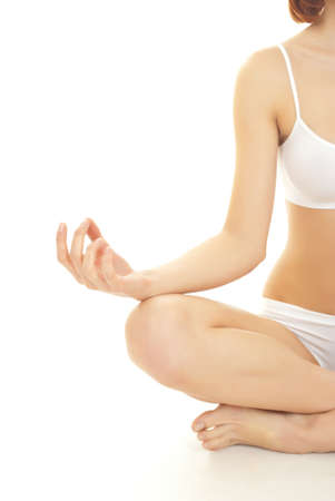 Portrait of a cute young female practicing yoga photo