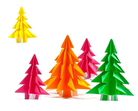 Christmas trees made of paper on white background photo