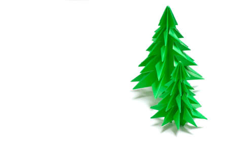 Christmas trees made of paper on white background Stock Photo - 11839154