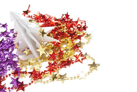 Christmas tree made of paper on white background photo