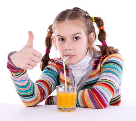 little girl drinking orange juice photo