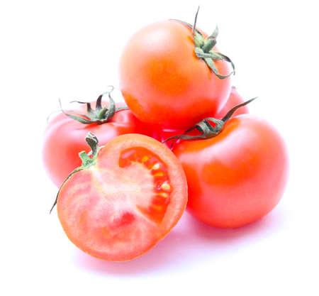 Fresh tomatoes isolated on white photo