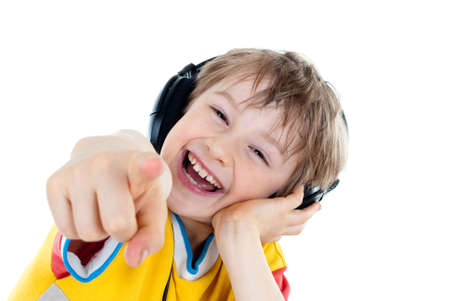 Portrait of a sweet young boy listening to music on headphones against white background Stock Photo - 13191069