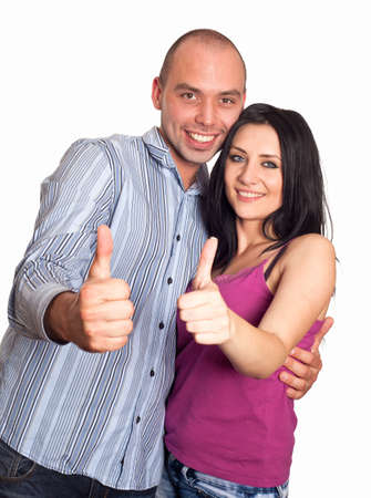 Two young smiling people with thumbs-up gesture isolated on white photo