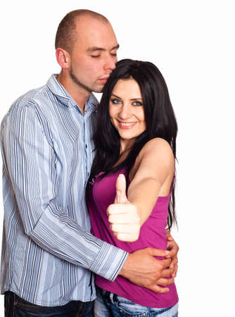 Man and woman with thumbs-up gesture isolated on white photo