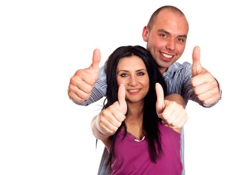 thumbsup: Two young smiling people with thumbs-up gesture isolated on white