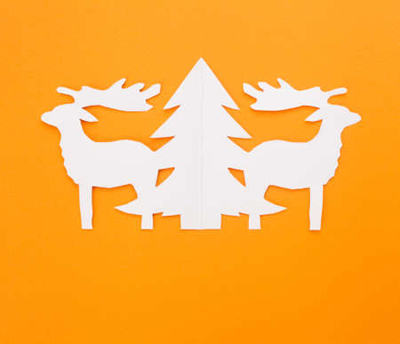 Template Christmas cards. New Year's deers on a red background. Stok Fotoğraf