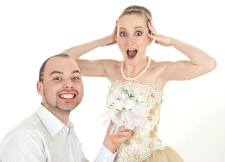 Beautiful smiling wedding couple. Bride in surprise over white background photo