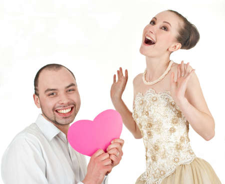 Beautiful smiling wedding couple over white background photo