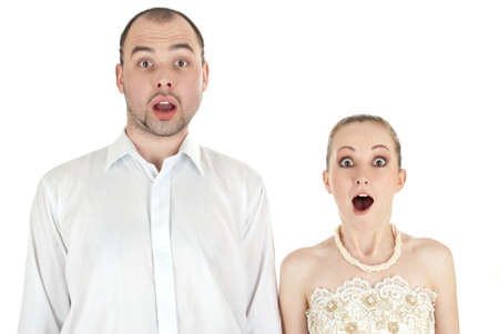 Beautiful funny wedding couple over white background photo