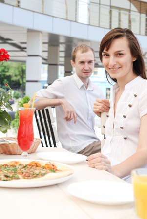 Young smiling couple in cafe photo