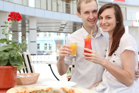 Portrait of  young man hugging his girlfriend in cafe photo