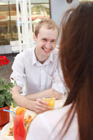 Young smiling man looking at a woman on date photo