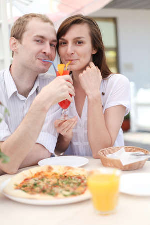Young couple drinking juice in cafe photo