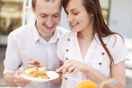 Young couple eating pizza in cafe Stock Photo - 15530725
