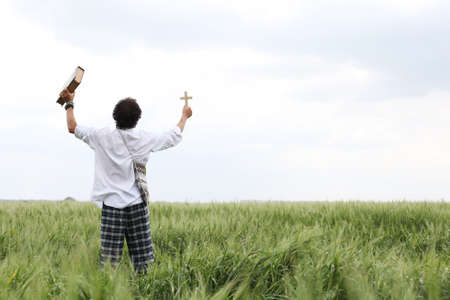 Man praying for good wheat year photo