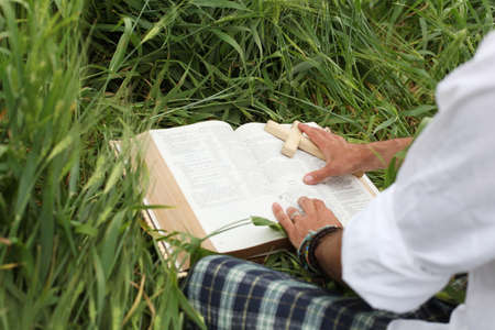 Man reading bible in summer Stock Photo - 15536425