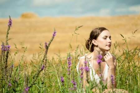 Young woman in the field Stock Photo - 15747452