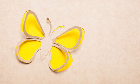 Image of abstract yellow butterfly handmade.Eco background. photo