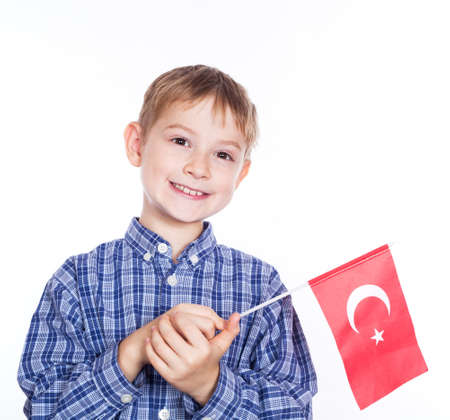 A little boy with turkish flag on the white background