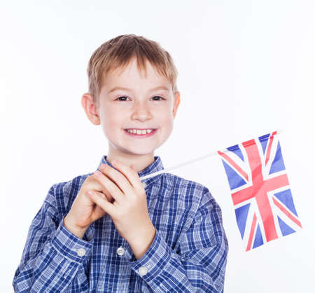 A little boy with english flag on the white background Stock Photo