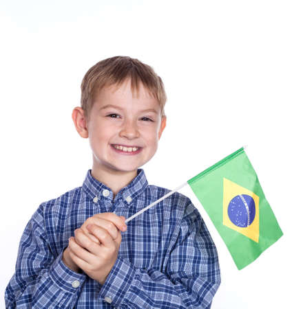 A little boy with brazilian flag on the white background photo