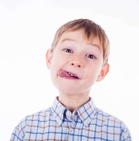 bad manners: Small boy is showing his tongue