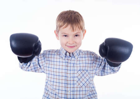 Little boy boxer on the white background photo