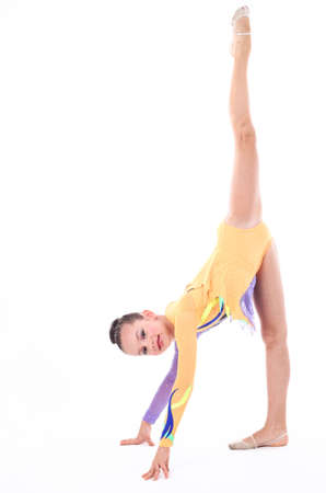 costume ball: Beautiful flexible girl gymnast  over white background