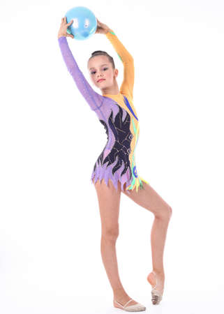 Beautiful flexible girl gymnast  over white background photo