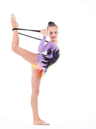 ball stretching: Beautiful flexible girl gymnast  over white background