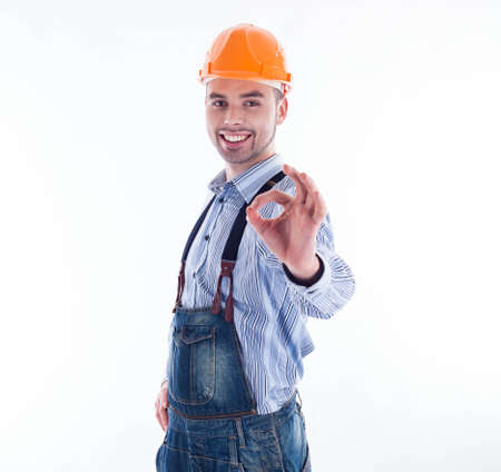Portrait of a construction worker with hardhat showing  ok sign. Stock Photo - 16657417
