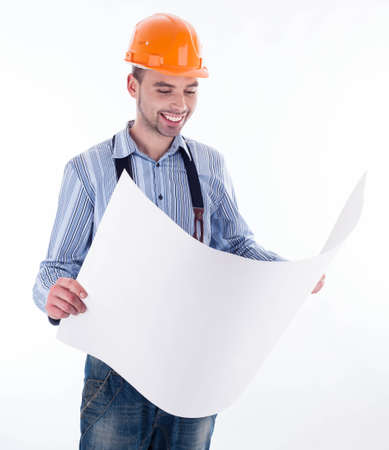 Male architect looking at blueprints against white background Stock Photo - 16657416