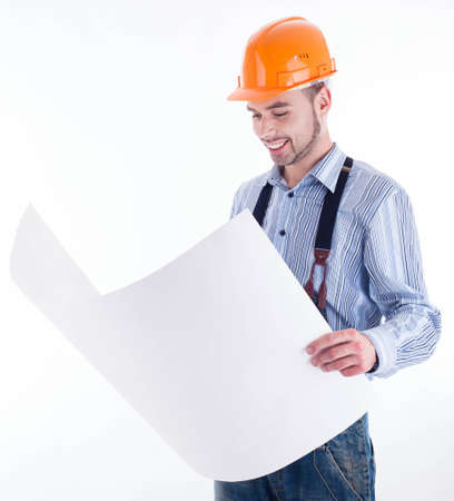 Male architect looking at blueprints against white background Stock Photo - 16657435