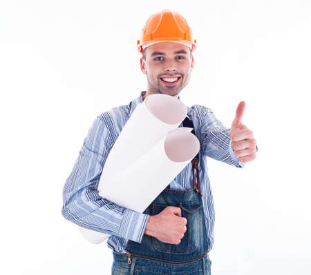 Male architect with blueprints against white background photo