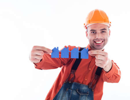 A builder man holding  paper houses. photo