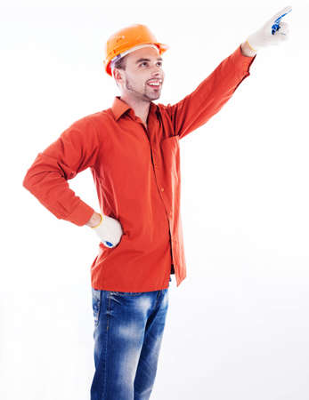 A builder pointing with  his finger photo