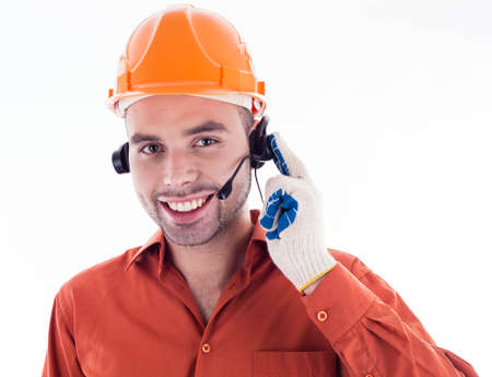 A builder with headphones photo
