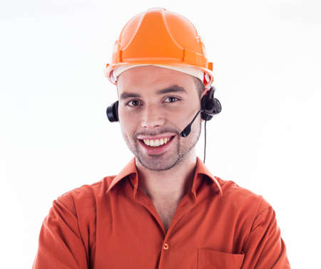 A builder with headphones Stock Photo - 16657479