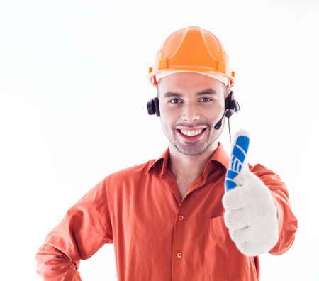 Handsome construction worker giving thumbs-up sign. photo
