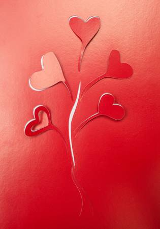 Orgami hearts cutout in the red Stock Photo - 17798520