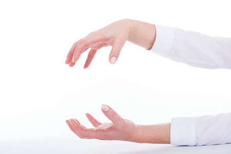 grasping: Isolated female hands in grasping gesture.