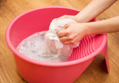 clothes washer: Hand delicate washing of clothes. Stock Photo