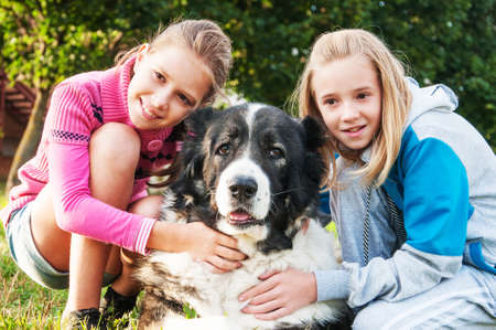 endear: beautiful girls and his dog posing outside