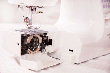 zigzagger: Sewing machine in a closeup with open shuttle