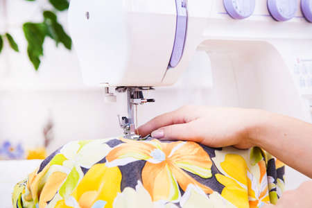 zigzagger: A tailor working on sewing machine from home Stock Photo