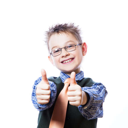Portrait of happy boy showing thumbs up gesture on the white background Standard-Bild