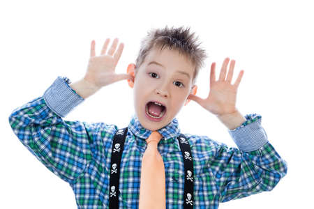 prankster: Little boy with funny face isolated on white