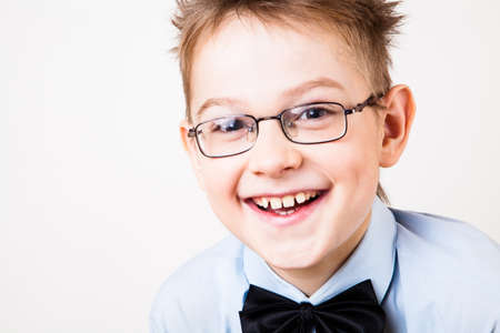 Photo of adorable young happy boy looking at camera. photo